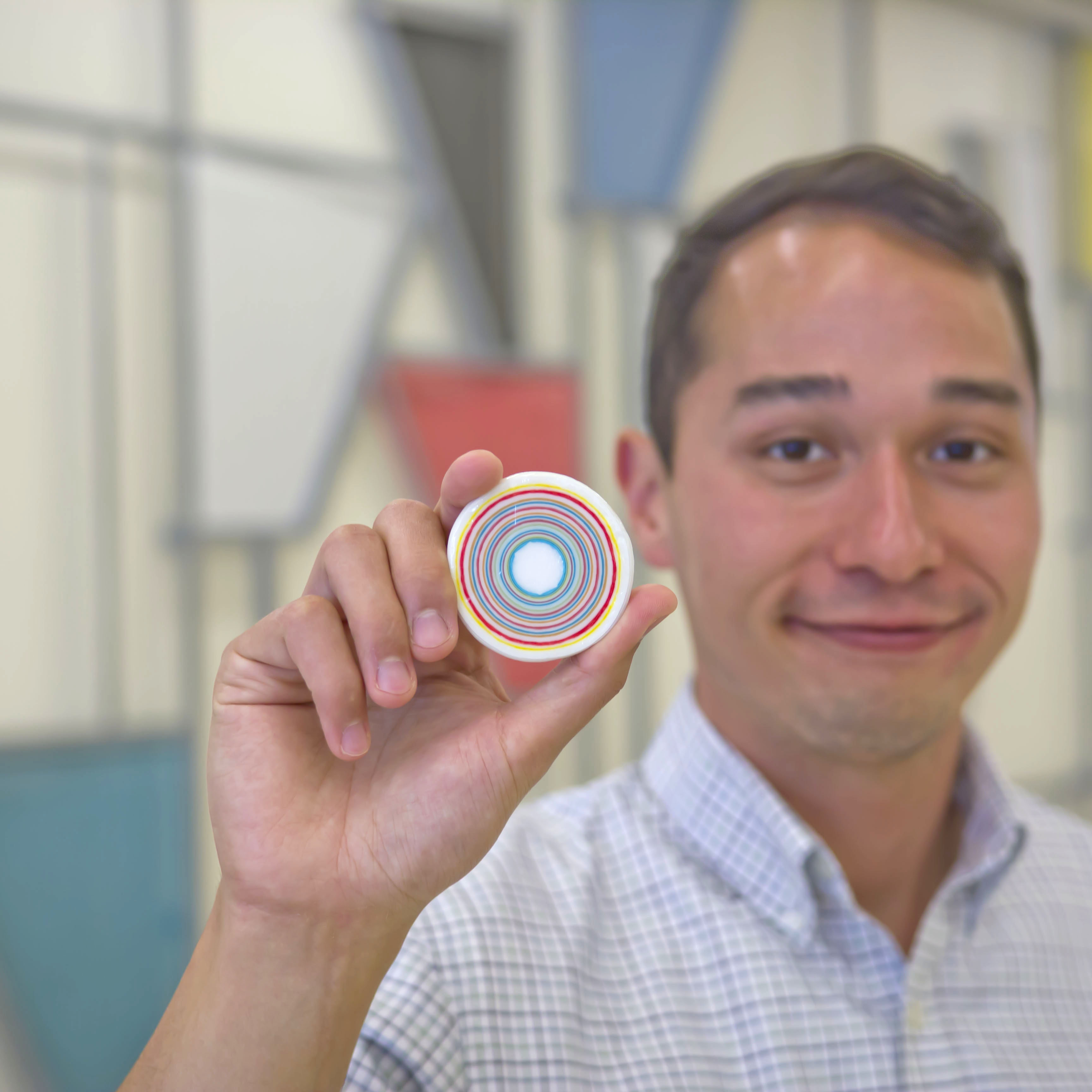 photo of researcher holding model of layer-by-layer nanoparticle