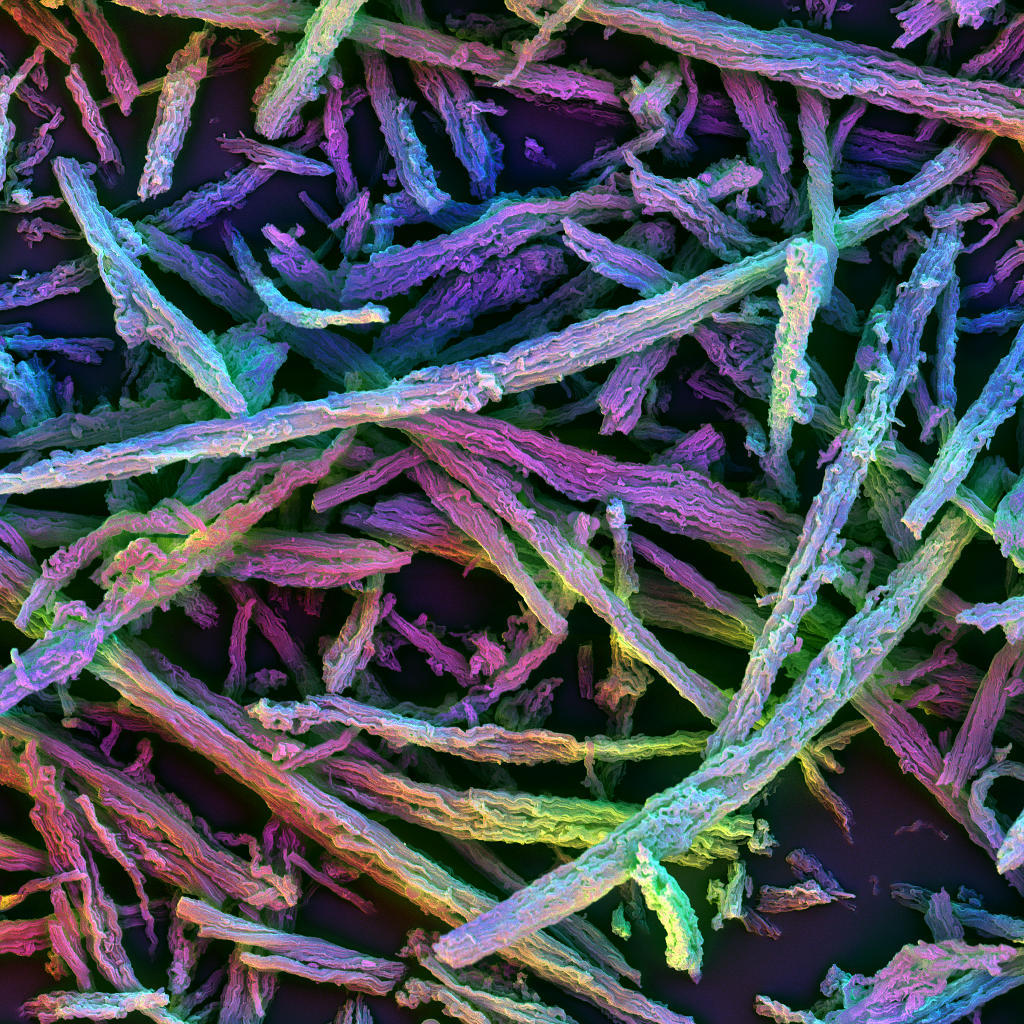 This is a multicolored image of the silica rods looking like a haystack under a scanning electron microscope