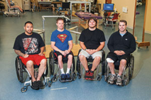 Picture of the four participants in the spinal stimulation study in their wheelchairs