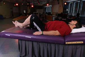Photo of participant Kent Stephenson raising his leg while his spinal cord is stimulated
