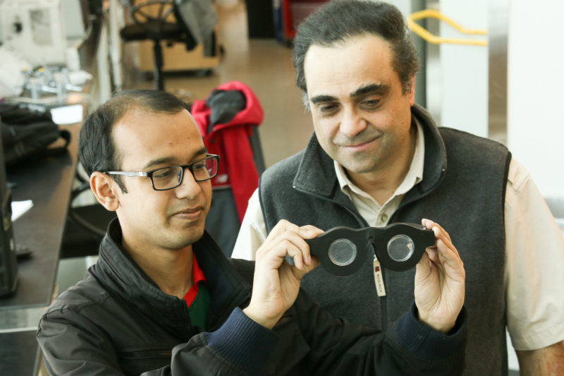 Mastrangelo, right, and doctoral student Nazmul Hasan holding smart glasses