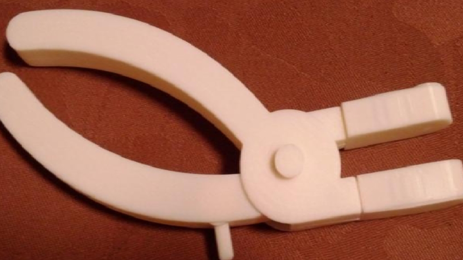 Photo of QuickStitch device