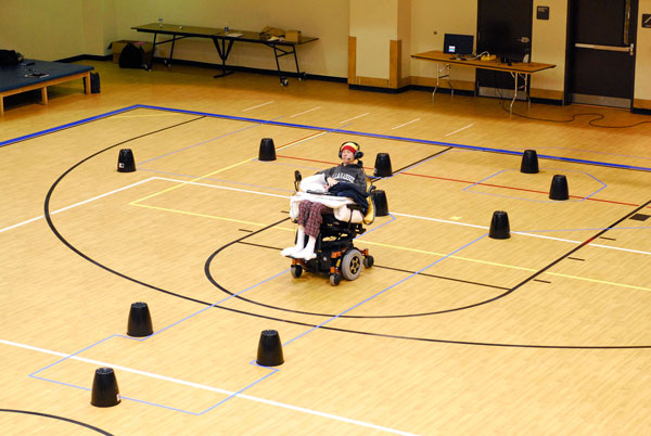 Cruise Bogle drives his wheelchair in an obstacle course using the Tongue Drive System.