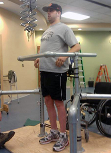 Paralyzed patient is testing spinal stimulation technique and standing on platform. Photo Credit: Dr. Jason Burdick, University of Pennsylvania