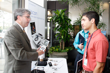 Researcher demonstrating how the hand-held V-scan device is used as an ultrasound scanner. Photo Credit: NIBIB