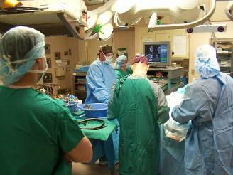 Photo of an operating room with doctors operating on a patient