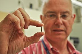 Dr. Weir holding implantable sensor