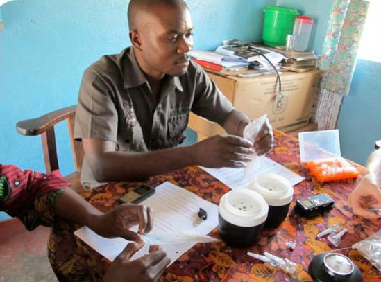 Health worked testing NINA prototype in Zambia