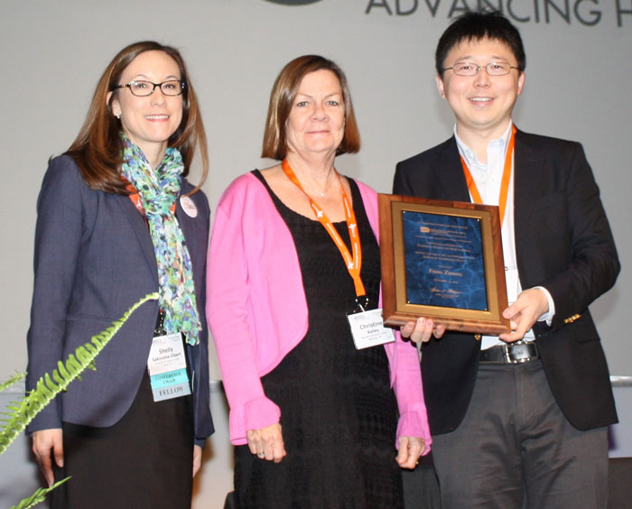 Dr. Christine Kelley, Acting Associate Director of Extramural Science Programs at NIBIB presents an award to the 2017 NIH-NIBIB Lecturer, Dr. Feng Zhang. Also pictured Dr. Shelly Sakiyama-Elbert, BMES Annual Meeting Co-chair.