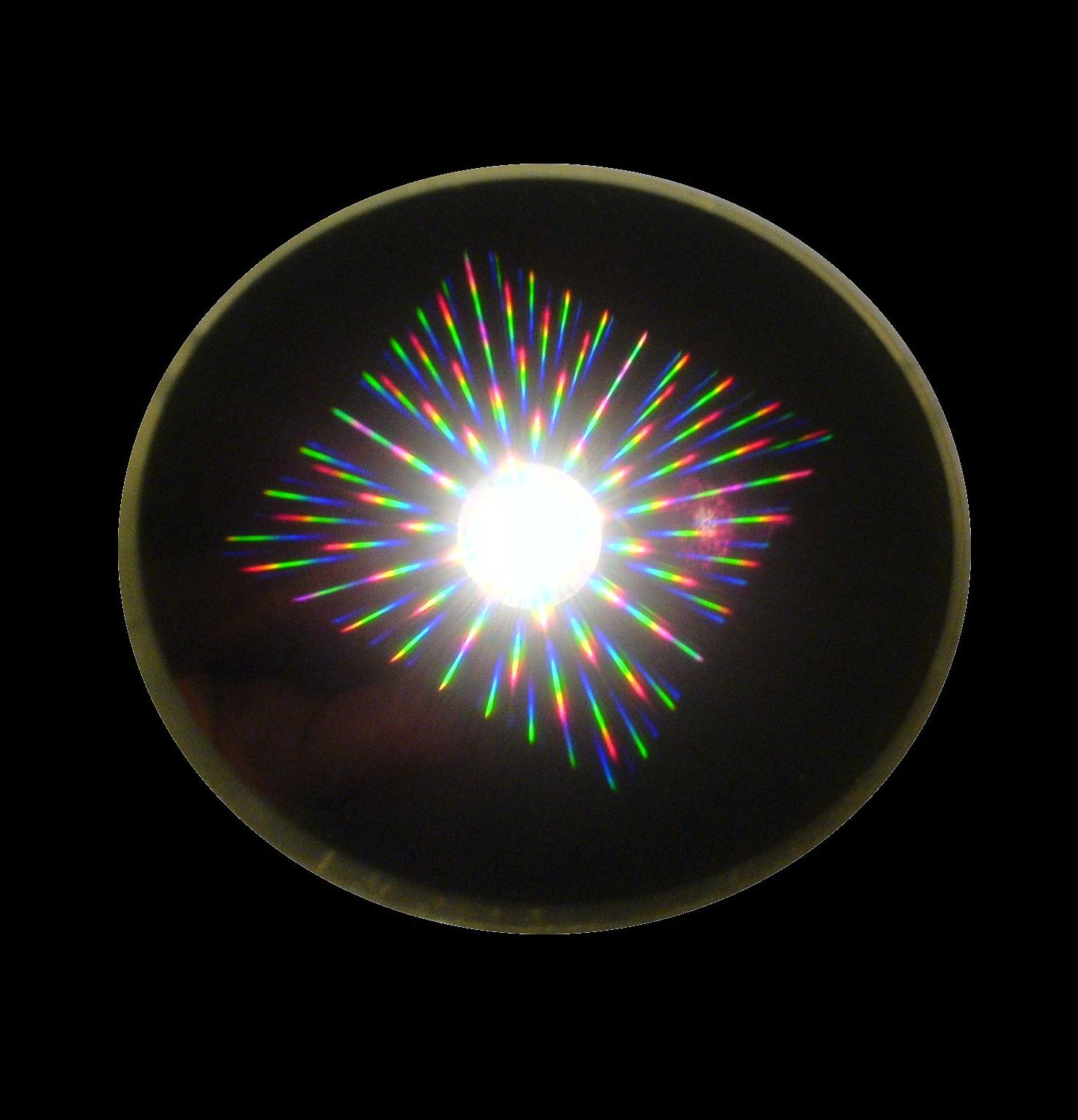 This image shows light scattering from grids of magnets on a wafer where they were made using conventional microfabrication techniques.