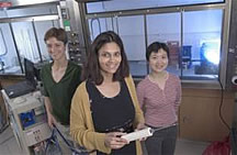 Dr. Nirmala Ramanujam (holding biopsy needle, center) and graduate students Carmalyn Lubawy (left) and Changfang Zhu have developed an optical probe to help doctors biopsy breast tissue more accurately. The probe slides into the hollow biopsy needle doctors currently use.