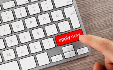 Computer keyboard with a key called apply now