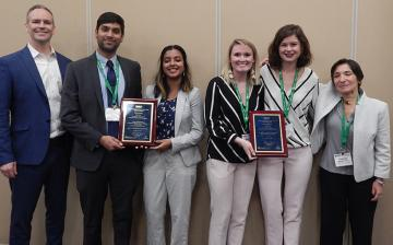 Georgia Tech students Bailey Klee and Rachel Mann (second and third from right), part of the team that won the HIV Prize are joined (L-R) by  James Rains, Pranav Dorbala, and Madhumita Baskaran (2nd place winners from Georgia Tech) and Zeynep Erim, Director, NIBIB Training Program (far right).