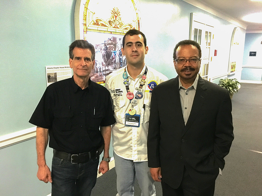 From left, FIRST Global founder Dean Kamen, Venebot team leader Kenny Urdaneta, and NIBIB Director Roderic I. Pettigrew.  Photo by NIBIB.