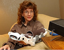 A robotic device (The Hand MentorT) helps people improve their hand function following a stroke.