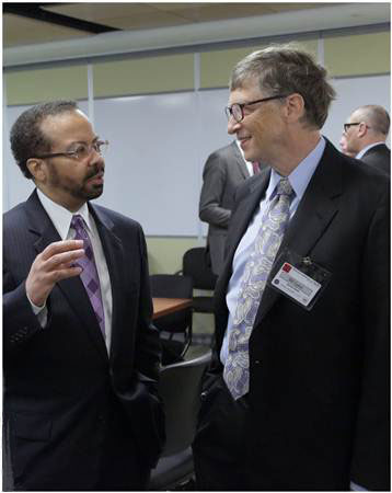 This is a photograph of the NIBIB director talking to Bill Gates